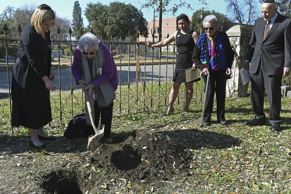 Holocaust survivors Rose Williams, 90, second from left and Anna Rado, 86, second from right, help shovel dirt during the burial of unidentified bone fragments from the Auschwitz death camp at the old Agudas Achim cemetery, Sunday, Jan. 28, 2018. The ceremony was held in observance of International Holocaust Remembrance Day. Temple Beth-el Rabbi Mara Nathan, left, and Rabbi Emeritus Samuel Stahl, right, officiated the ceremony. Also at the ceremony was Kristin Hernandez, Holocaust Memorial Museum of San Antonio collections manager, third from right.
