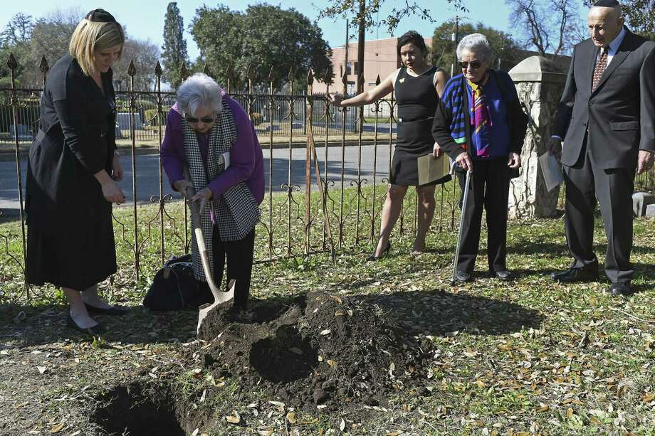 Holocaust survivors Rose Williams, 90, second from left and Anna Rado, 86, second from right, help shovel dirt during the burial of unidentified bone fragments from the Auschwitz death camp at the old Agudas Achim cemetery, Sunday, Jan. 28, 2018. The ceremony was held in observance of International Holocaust Remembrance Day. Temple Beth-el Rabbi Mara Nathan, left, and Rabbi Emeritus Samuel Stahl, right, officiated the ceremony. Also at the ceremony was Kristin Hernandez, Holocaust Memorial Museum of San Antonio collections manager, third from right. Photo: JERRY LARA, Staff / San Antonio Express-News / © 2018 San Antonio Express-News