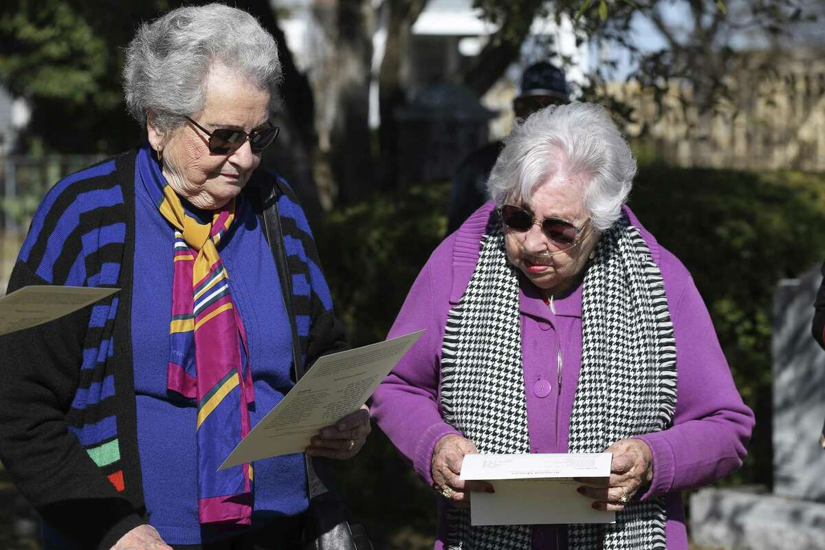 Holocaust survivors Anna Rado, 86, left, and Rose Williams, 90, attend the burial ceremony of unidentified bone fragments from the Auschwitz death camp at the old Agudas Achim cemetery, Sunday, Jan. 28, 2018. The ceremony was held in observance of International Holocaust Remembrance Day.