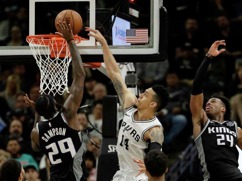 San Antonio Spurs guard Danny Green (14) drives to the basket between Sacramento Kings defenders JaKarr Sampson (29) and Buddy Hield (24) during the first half of an NBA basketball game, Monday, April 9, 2018, in San Antonio. (AP Photo/Eric Gay) Photo: Eric Gay, Associated Press / Copyright 2018 The Associated Press. All rights reserved.