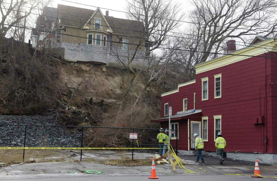 A view of a home up on Barney Street, where the hill gave way causing damage to buildings below on Nott Terrace, seen here on Sunday, Jan. 28, 2018, in Schenectady, N.Y.  (Paul Buckowski/Times Union) / (Paul Buckowski/Times Union)