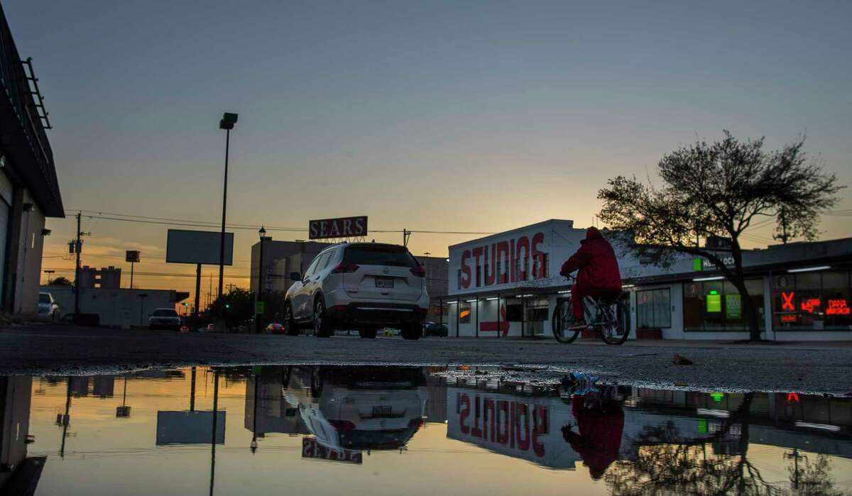 """A cyclists passes an empty lot along Fannin Street in Midtown, Wednesday, Jan. 17, 2018, in Houston. The area, centered around the Sears building, is being proposed for redevelopment as part of an """"innovation corridor"""" stretching from downtown through the medical center.( Mark Mulligan / Houston Chronicle )"""