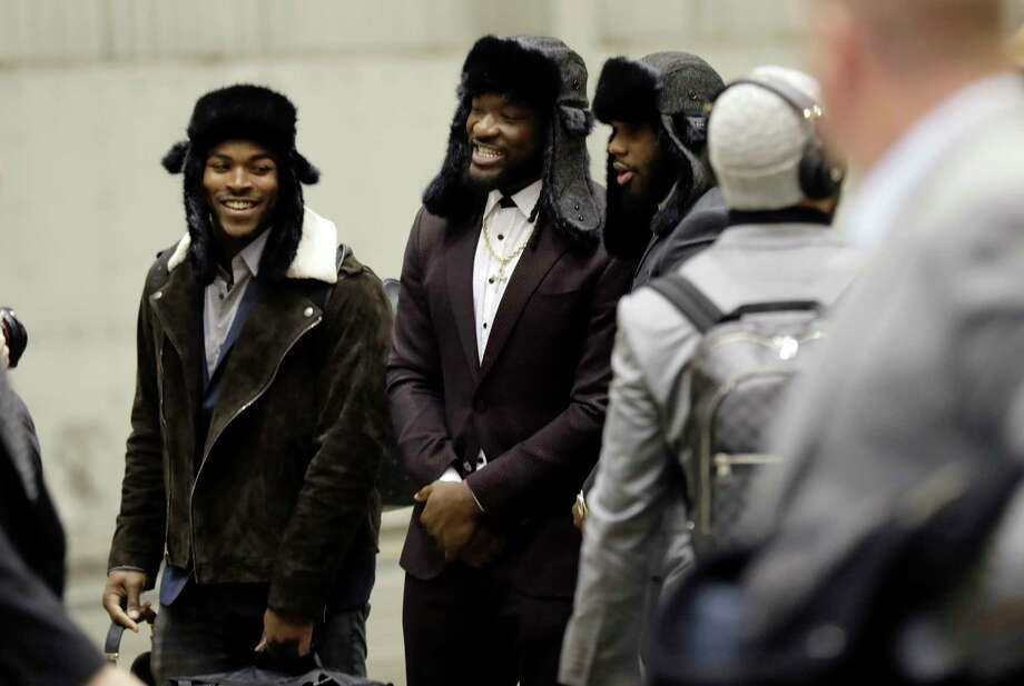 Wearing winter hats, Philadelphia Eagles running backs Corey Clement, left, and LeGarrette Blount, center, arrive in Minneapolis with their teammates to begin preparations for Super Bowl LII on Sunday. Photo: Eric Gay, STF / Copyright 2018 The Associated Press. All rights reserved.