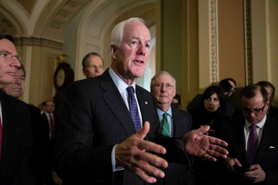 Senate Majority Whip John Cornyn, R-Texas, joined from by, Sen. John Barrasso, R-Wyo., Sen. Roy Blunt, R-Mo., Sen. John Thune, R-S.D., and Senate Majority Leader Mitch McConnell, R-Ky., speaks to reporters following a weekly, closed-door strategy session, at the Capitol in Washington, Tuesday, Jan. 9, 2018. (AP Photo/J. Scott Applewhite) Photo: J. Scott Applewhite, STF / Copyright 2018 The Associated Press. All rights reserved.
