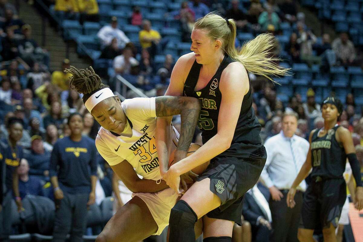 West Virginia's Theresa Ekhelar, left, battles Baylor's Lauren Cox, right, for a rebound in the second half of Sunday's Big 12 clash in Morgantown, W.Va. The No. 3 Lady Bears won 83-72.
