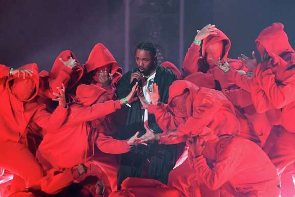Kendrick Lamar performs during the 60th annual Grammy Awards show. Lamar won five awards Sunday night, including best rap album.