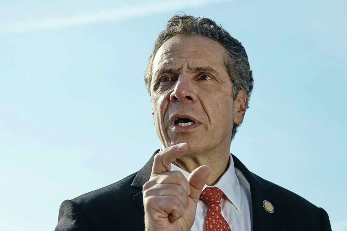 New York Gov. Andrew Cuomo speaks during a news conference in New York, Jan. 21, 2018. Cuomo, Connecticut Gov. Dannel P. Malloy and other Democratic governors are planning a suit over the federal tax overhaul.