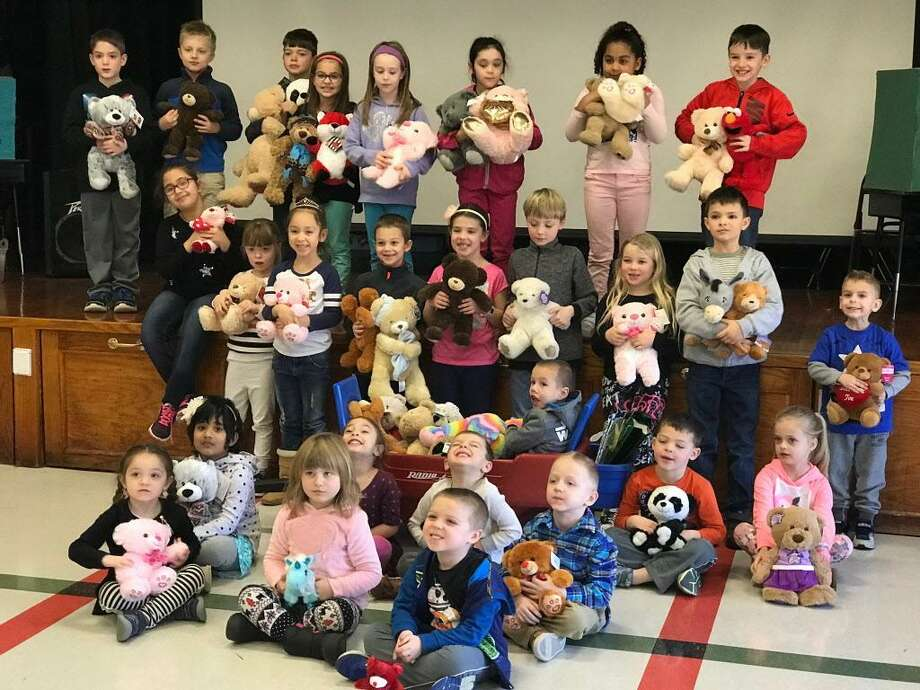 Pre-K to second-grade students at Edna C. Stevens School in Cromwell collected 200 Teddy bears to be sent to a California school district whose families were affected by the recent fires. Photo: Cassandra Day / Hearst Connecticut Media