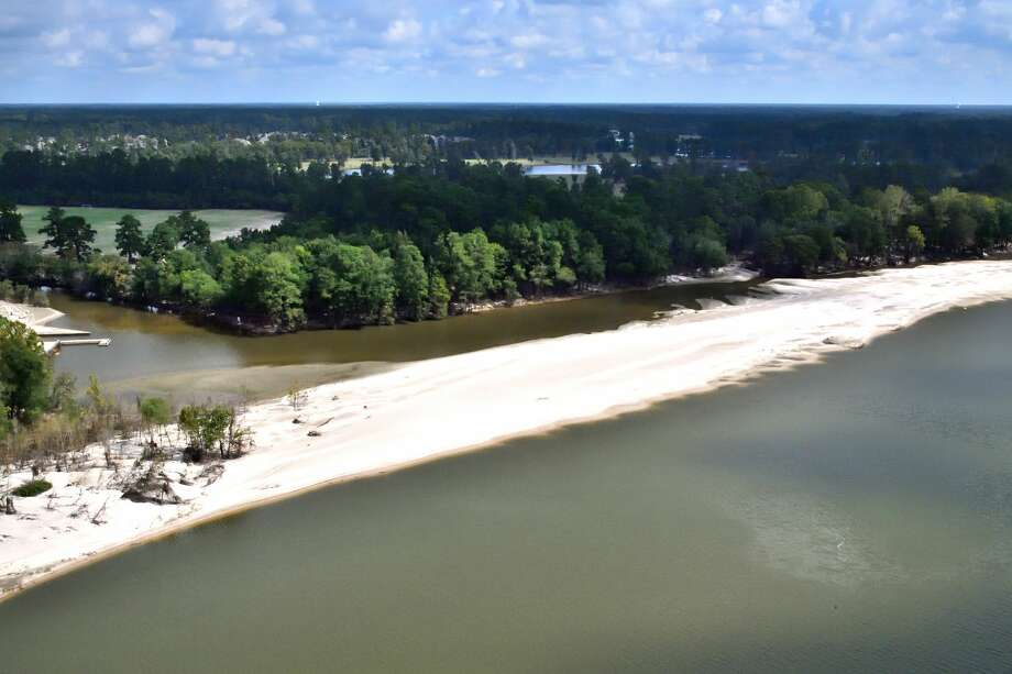 A drainage ditch (center left) that empties the entire western part of Kingwood at River Grove Park on the west fork of the San Jacinto has been virtually closed off by a new sandbar. An estimated 500+ homes above this point flooded. The boat dock (also center left) is now unusable. Photo: Bob Rehak