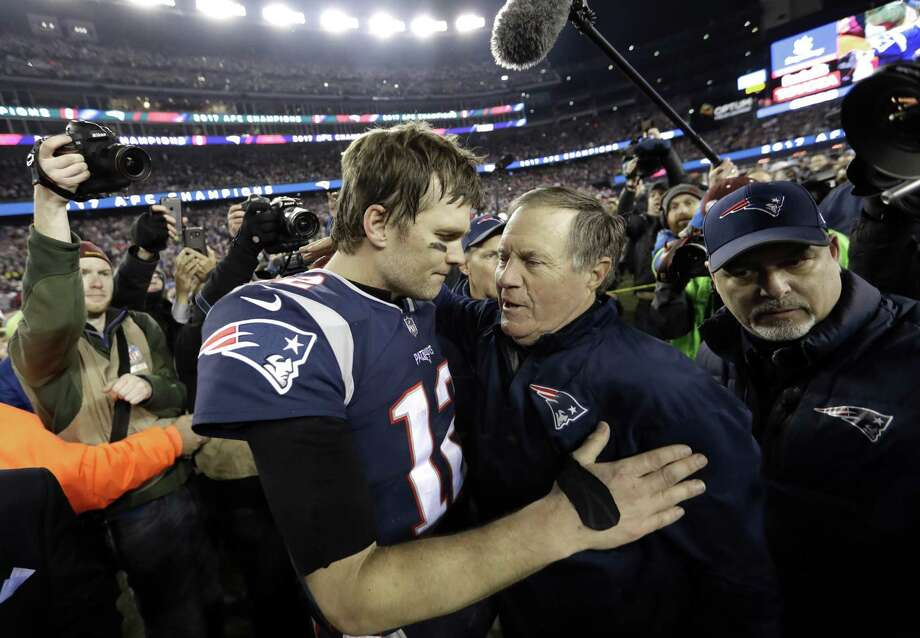 New England Patriots quarterback Tom Brady, left, hugs coach Bill Belichick after the AFC championship NFL football game against the Jacksonville Jaguars, Sunday, Jan. 21, 2018, in Foxborough, Mass. The Patriots won 24-20. (AP Photo/David J. Phillip) Photo: David J. Phillip, STF / Associated Press / Copyright 2018 The Associated Press. All rights reserved.