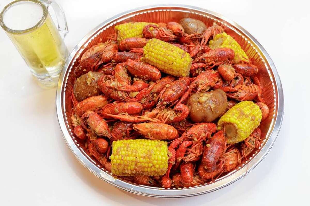 Digging into that first pound of crawfish with all the trimmings when the season first starts.