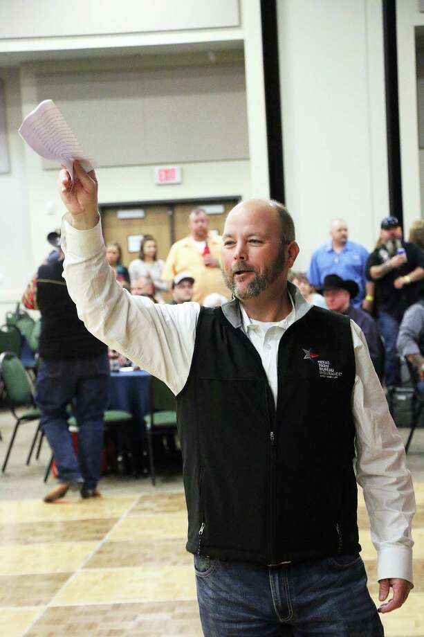 Mark Sjolander was one of many spotters during the live auction for the Boots and Bullets fundraiser for the Dayton VFD last Saturday night. Photo: David Taylor