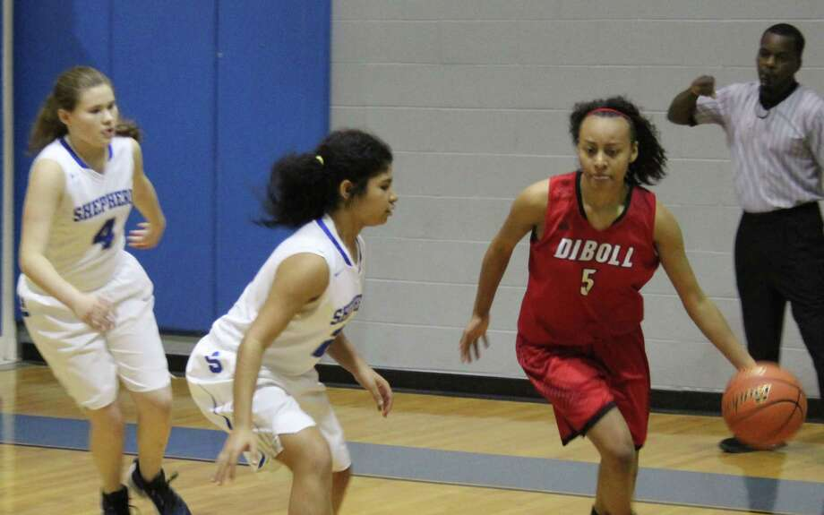 Lady Pirates Sky Rushing (left) and Kourtney Lee (middle) move in to block off a Diboll Lady Jack in possession of the ball. Photo: Jacob McAdams