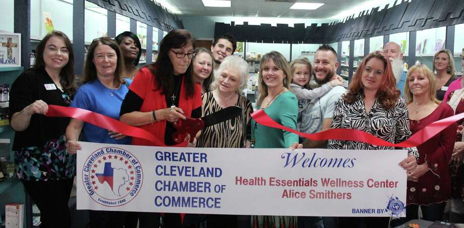 Alice Currie Smithers cuts the ribbon to welcome her business Health Essentials Wellness Center into the Greater Cleveland Chamber of Commerce on Jan. 27. Photo: Jacob McAdams