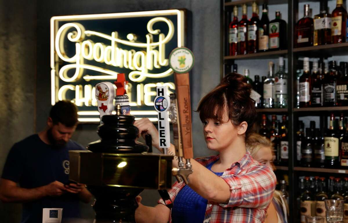 Bartender Christa Havican pours a beer at Goodnight Charlie's, a new honky-tonk in the Montrose district.