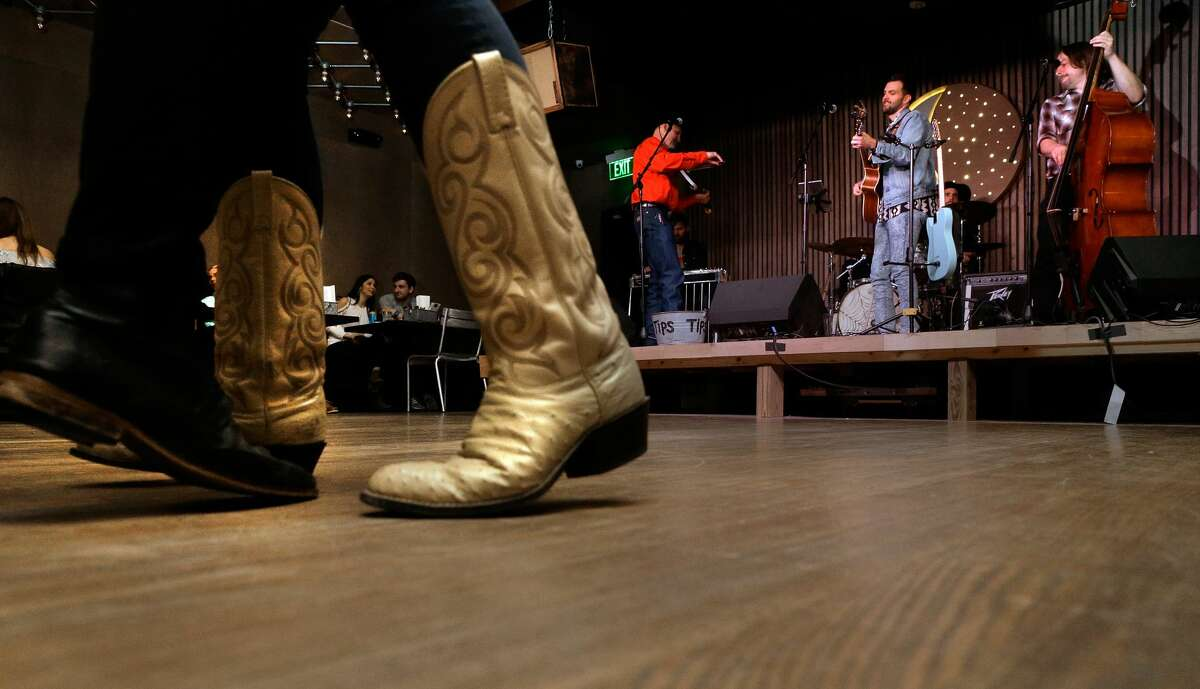 Dancers move to country music covers performed by Neon Rainbow at Goodnight Charlie's, a new Honky Tonk in the Montrose district in Houston, TX, Friday, Jan. 26, 2018 (Michael Wyke / For the Chronicle)