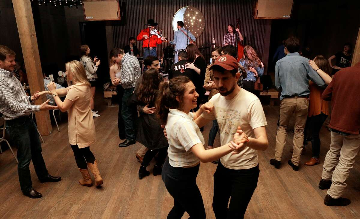 PHOTOS: Goodnight Charlie's in Montrose Dancers move to country music covers performed by Neon Rainbow at Goodnight Charlie's, a new honky-tonk in the Montrose district. See more photos from inside the bar...