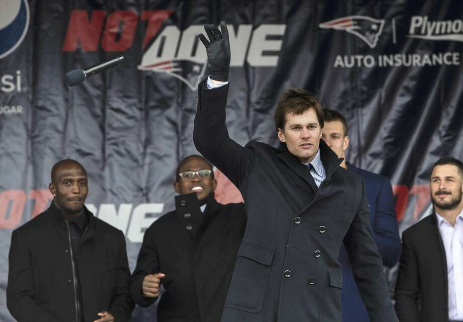 FOXBOROUGH, MA - JANUARY 29: New England Patriots quarterback Tom Brady drops the mic  after speaking to fans at a Super Bowl send off rally for the team at Gillette Stadium in Foxborough, Massachusetts on Jan. 29, 2018. (Photo by Keith Bedford/The Boston Globe via Getty Images) Photo: Boston Globe/Boston Globe Via Getty Images