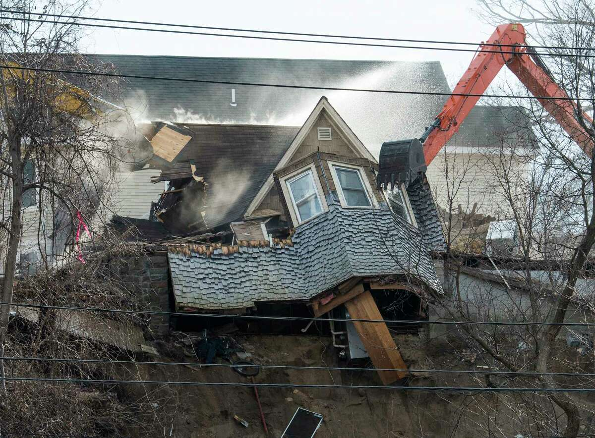 Demolition begins on the homes Barney Street after a weekend mudslide Monday, Jan. 29, 2018 in Schenectady, N.Y. (Skip Dickstein/Times Union)