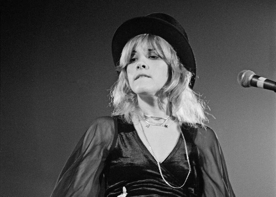 Stevie Nicks, with trademark top hat, performs with Fleetwood Mac in 1975. Photo: Fin Costello /Redferns / 1975 Fin Costello
