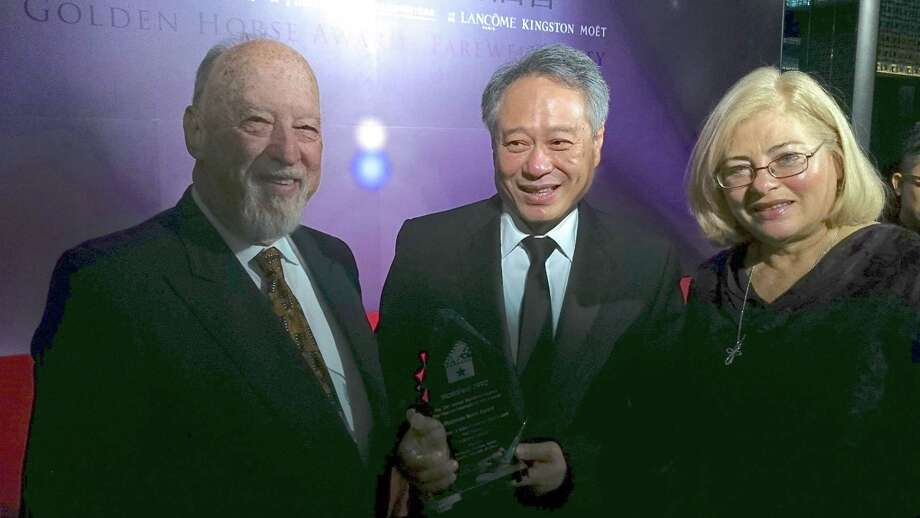 Hunter Todd, (left) founder of WorldFest, with director Ang Lee with his award at the 1992 WorldFest film festival, and Kathleen Haney, WorldFest Program Director. Photo: WorldFest
