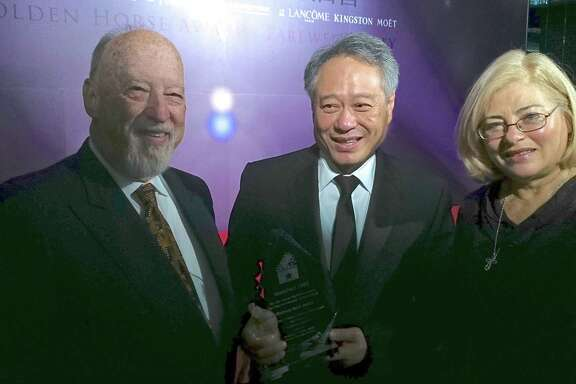 Hunter Todd, (left) founder of WorldFest, with director Ang Lee with his award at the 1992 WorldFest film festival, and Kathleen Haney, WorldFest Program Director.