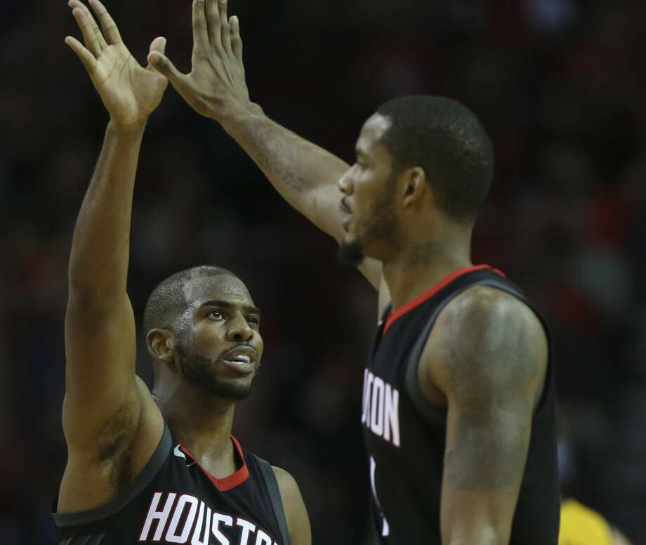 Houston Rockets guard Chris Paul (3) and forward Trevor Ariza (1) high-five each other during the fourth quarter of a NBA game against the Indiana Pacers at Toyota Center on Wednesday, Nov. 29, 2017, in Houston. The Houston Rockets defeated the Indiana Pacers 118-97. ( Yi-Chin Lee / Houston Chronicle ) Photo: Yi-Chin Lee/Houston Chronicle