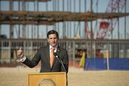 """Representative Brooks Landgraf speaks 01/29/18 during the """"topping out"""" ceremony for the new engineering building. Tim Fischer/Reporter-Telegram"""