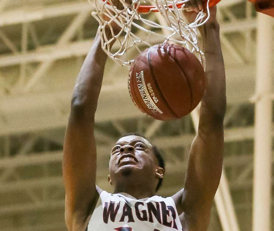 Wagner's Justice Tolbert dunks the ball during the second half of their District 27-6A boys basketball game with Clemens at Wagner on Friday, Jan. 26, 2018.  Wagner beat Clemens 106-71.  MARVIN PFEIFFER/mpfeiffer@express-news.net Photo: Marvin Pfeiffer, Staff / San Antonio Express-News / Express-News 2018