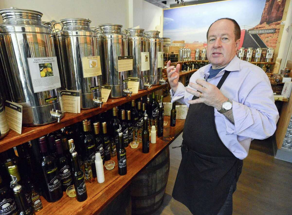 Rick Doyle, owner of Stagecoach Olive Oil & Vinegar Co., is photographed on Wednesday, Jan. 24, 2018 at its store at 180 Bedford St., in downtown Stamford, Conn.