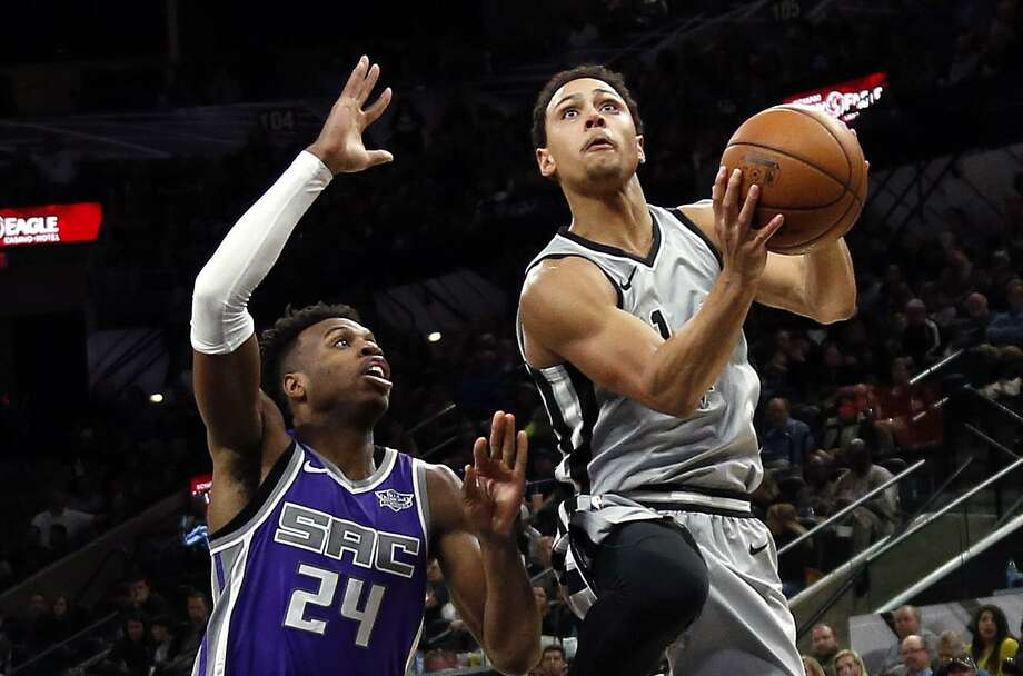 Bryn Forbes #11 of the San Antonio Spurs drives past Buddy Hield #24 of the Sacramento Kings on Sunday, January 28, 2018 in San Antonio,  Texas at AT&T Center. Photo: Ronald Cortes, For The San Antonio Express News / 2017 Ronald Cortes
