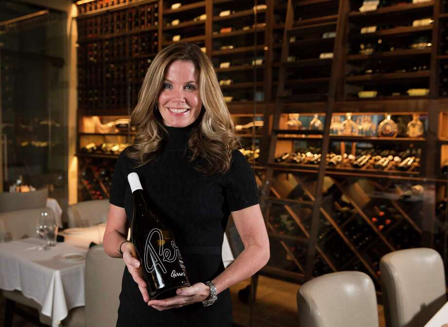 Perry's Steakhouse Sommelier Susi Zivanovic poses for a photo with a bottle of Perry's Reserve Chardonnay on Wednesday, Jan. 17, 2018, in Houston. The chardonnay comes with four sizes: Standard, 750ml; Magnum, 1.5 liters, Double Magnum, 3 liters and Imperial, 5 litters. ( Yi-Chin Lee / Houston Chronicle ) Photo: Yi-Chin Lee, Houston Chronicle / © 2018  Houston Chronicle