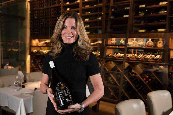 Perry's Steakhouse Sommelier Susi Zivanovic poses for a photo with a bottle of Perry's Reserve Chardonnay on Wednesday, Jan. 17, 2018, in Houston. The chardonnay comes with four sizes: Standard, 750ml; Magnum, 1.5 liters, Double Magnum, 3 liters and Imperial, 5 litters. ( Yi-Chin Lee / Houston Chronicle )