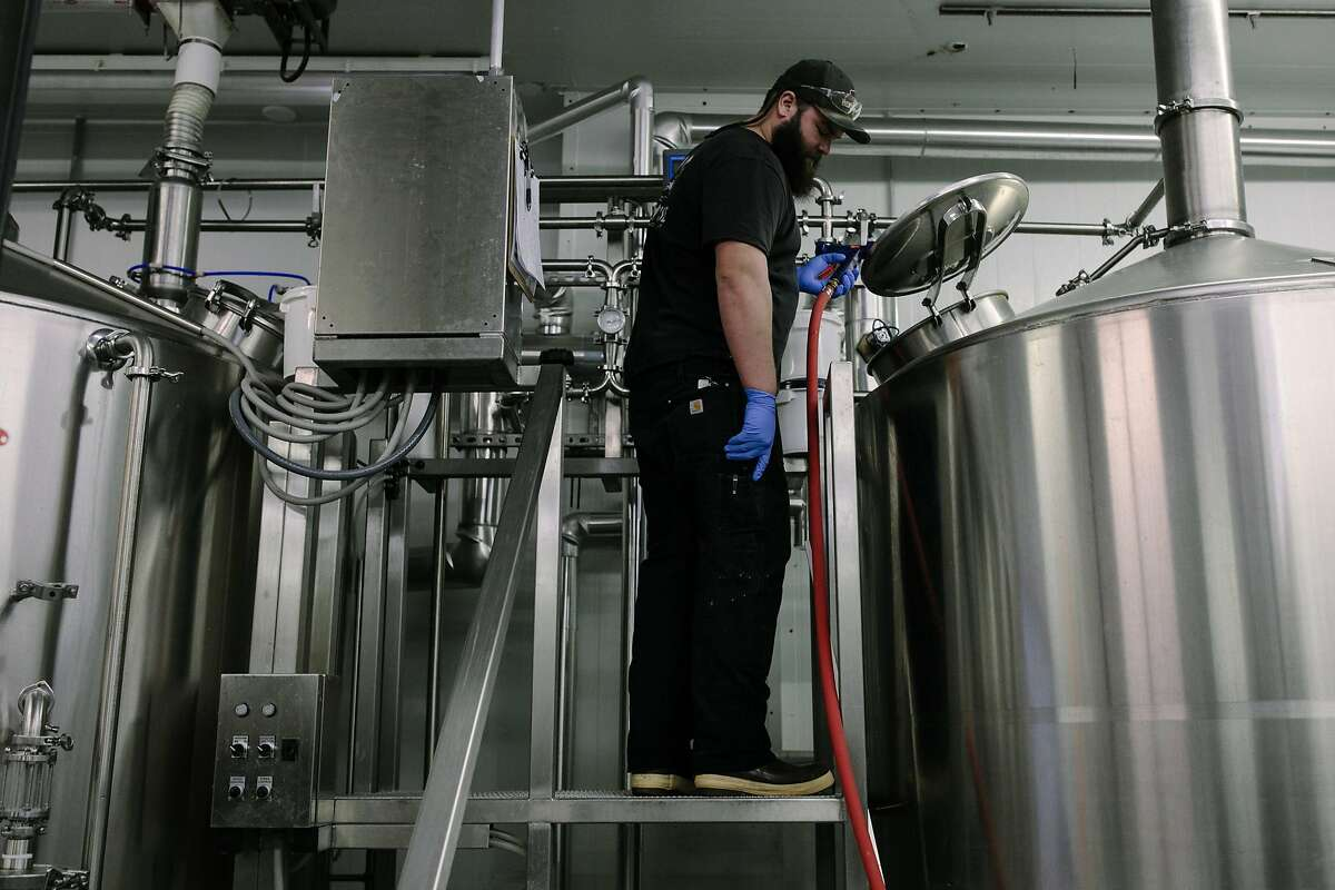 Nick Moreira of HenHouse Brewery checks the mash tun as dozens of brewers from the North Bay gathered for a one-time beer for 2018 Beer Week in Santa Rosa, Calif. Friday, Jan. 19, 2018.