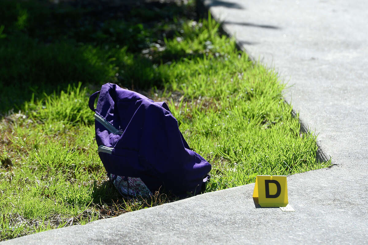 An evidence marker sits next to a bag at the scene of a fatal shooting in the 1100 block of Church Street in Beaumont on Monday. The female victim was taken to St. Elizabeth's Hospital where she died. Photo taken Monday 1/29/18 Ryan Pelham/The Enterprise