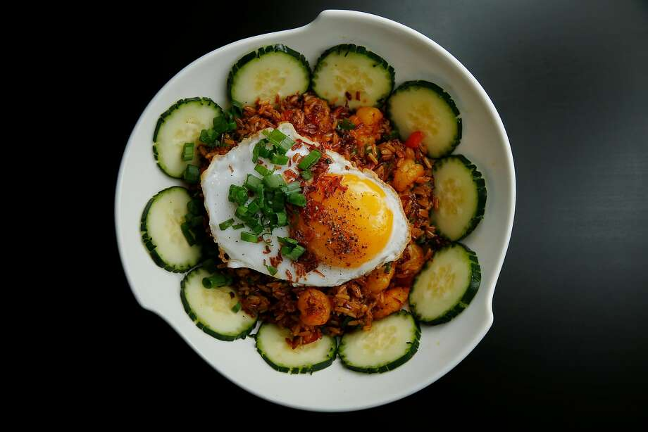 Brown fried rice with cucumbers and topped with an egg at the Temple Club in Oakland. Photo: Santiago Mejia, The Chronicle