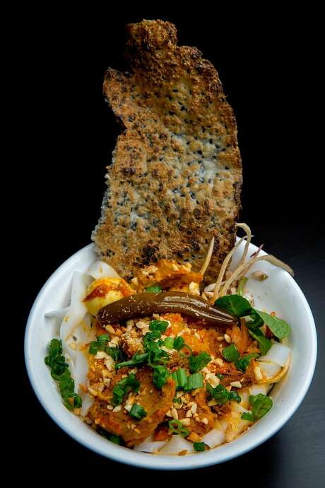 Mi Quang Phu Chiem, a special dish inspired from Quang Nam province with shrimp, pork, shallots, annatto oil, crushed peanut, herbs and a toasted sesame chip, at the Temple Club in Oakland. Photo: Santiago Mejia, The Chronicle