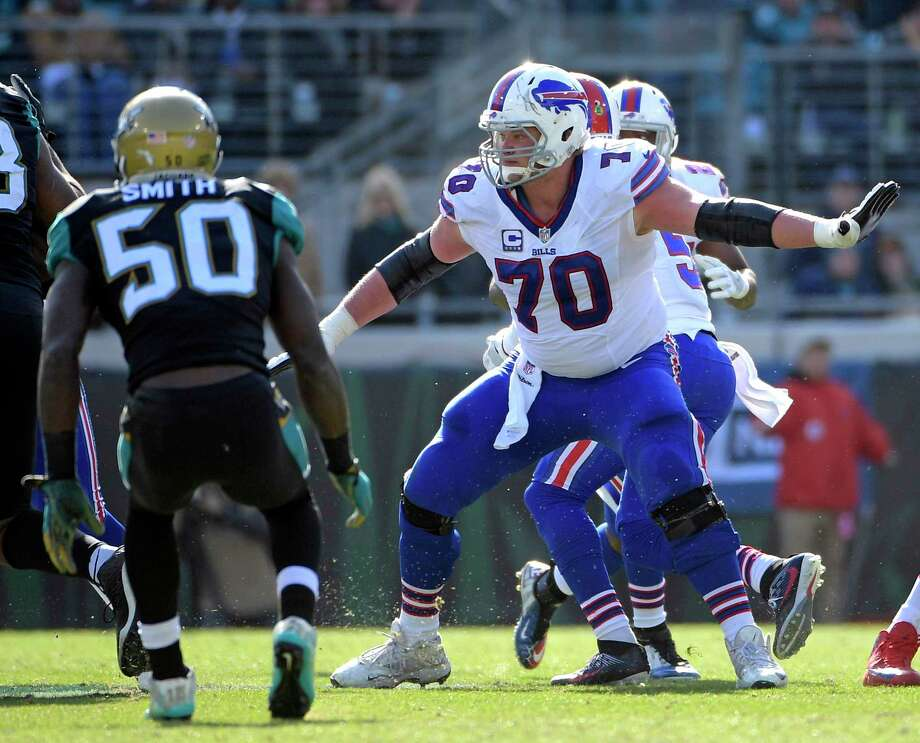 FILE - In this Sunday, Jan. 7, 2018, file photo, Buffalo Bills center Eric Wood (70) looks to block Jacksonville Jaguars outside linebacker Telvin Smith (50) during the first half of an NFL wild-card playoff football game in Jacksonville, Fla. Wood is retiring after nine seasons as a result of a debilitating neck injury. He revealed his decision in a statement the Bills posted on their Twitter account on Friday, Jan. 26, 2018. (AP Photo/Phelan M. Ebenhack, File) Photo: Phelan M. Ebenhack, Associated Press / FR121174 AP