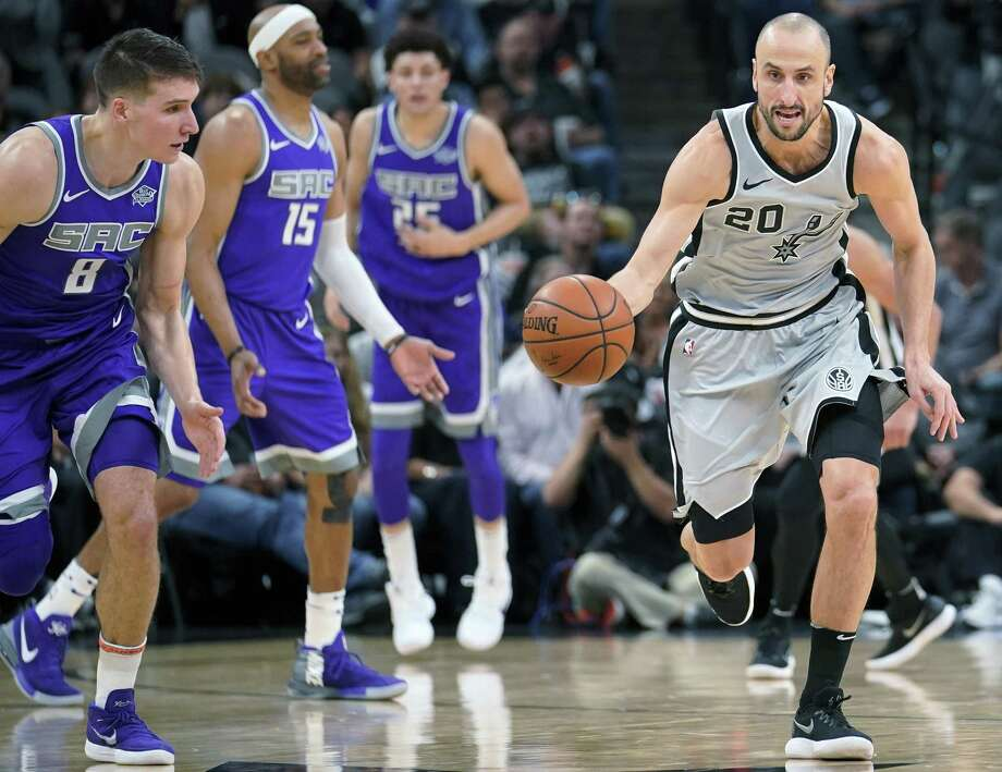 San Antonio Spurs' Manu Ginobili (20) steals the ball as Sacramento Kings' Bogdan Bogdanovic (8) looks on during the second half of an NBA basketball game, Sunday, Jan. 28, 2018, in San Antonio. San Antonio won 113-98. (AP Photo/Darren Abate) Photo: Darren Abate, FRE / Associated Press / FR115 AP