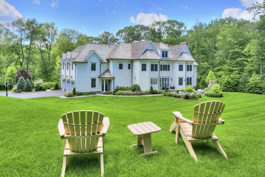The property comprises two level and sloping acres, a thicket of trees offering privacy screening, a patio and fireplace.