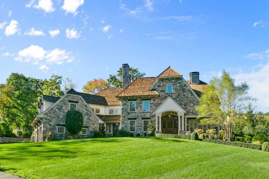 The 10,901-square-foot stone colonial manor house at 5 Devon Road sits on a knoll in the Greens Farms neighborhood. Photo: Oliver Bencosme / TaneFilms.