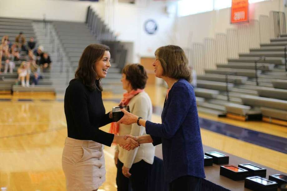 Emma Christie, left, of Greenwich, receives her ring from school president Janet Riggs commemorating the Gettysburg College women's lacrosse team winning the 2017 NCAA Division III national championship. The ring ceremony and the unveiling of the national championship banner took place Saturday at Bream Gym on the Gettysburg, Pa., school campus. Christie was a senior tri-captain on the Bullets' championship team. She scored 41 goals and had nine assists in 23 games from her attack position. Photo: Photo Courtesy / Gettysburg College