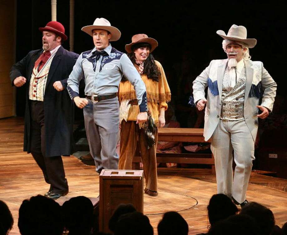 """John Saunders as Charlie Davenport, Jason Whitfield as Frank Butler, Karla Shook as Annie Oakley and Kevin Kelly as Buffalo Bill in """"Annie Get Your Gun."""" (Mac-Haydn Theate Staff Photo)"""