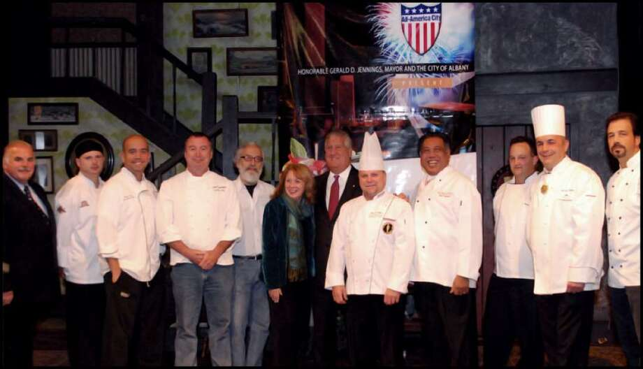 Albany Mayor Jerry Jennings, center, and Capital Rep's Maggie Mancinelli-Cahill, on Jennings' immediate left, accompany some of the chefs participating in the inaugural Wine & Dine for the Arts: Albany Chefs' Food & Wine Festival. (Wine & Dine For The Arts Photo)