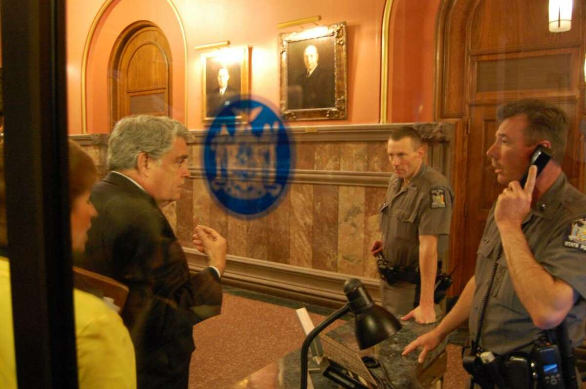 jimmy Vielkind/times union Assemblyman Jack McEneny of Albany leads colleagues to the governor?s office at the Capitol Wednesday to protest state furlough plans. Assemblywoman Barbara Lifton, an Ithaca Democrat, is at left. (Jimmy Vielkind/Times Union)