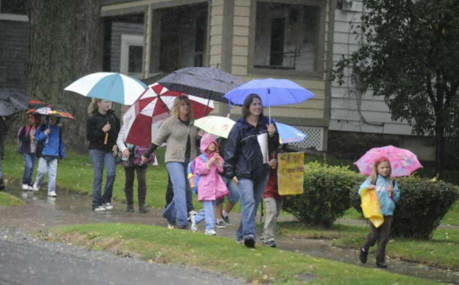 Jill Bogdanowicz-Wilson, second from right, joins up with other walk-to-school students and parents on Belmont Avenue in Schenectady  on Oct. 7. (Skip Dickstein/Times Union)