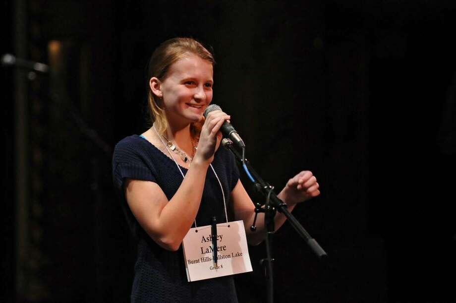 Burnt Hills-Ballston Lake eighth grader Ashley LaMere smiles as she spells her final word correctly and wins the 2010 Capital Region Spelling Bee at Proctors Theatre in Schenectady on Monday, March 15, 2010. She is in Washington, D.C., this week for the national championships. (Philip Kamrass / Times Union)
