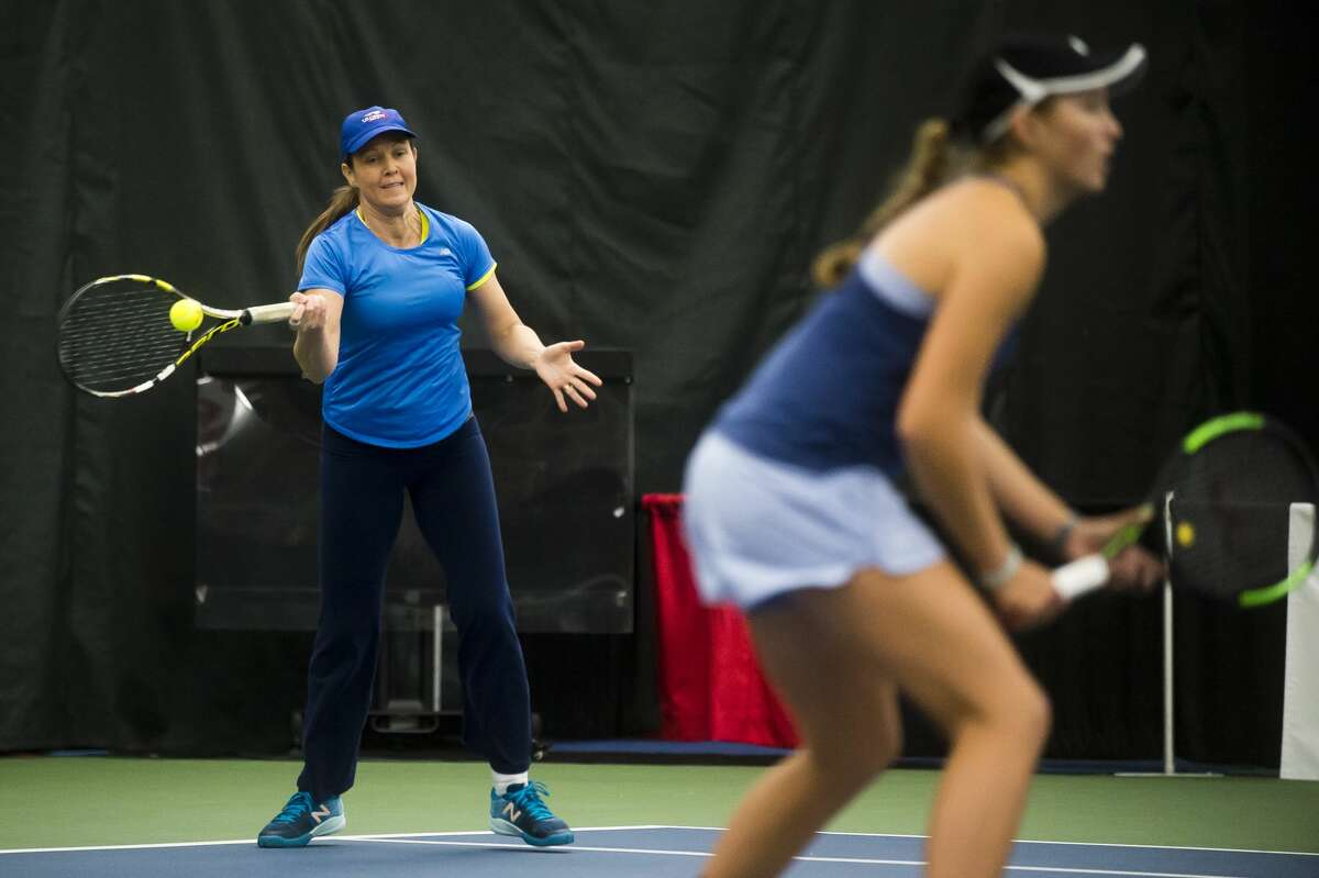 Liezel Huber returns the ball in a doubles match with Anne (Miller) Borus, Kari Miller and Ellie Coleman on Monday, Jan. 29, 2018 during the Dow Tennis Classic at the Greater Midland Tennis Center. (Katy Kildee/kkildee@mdn.net)