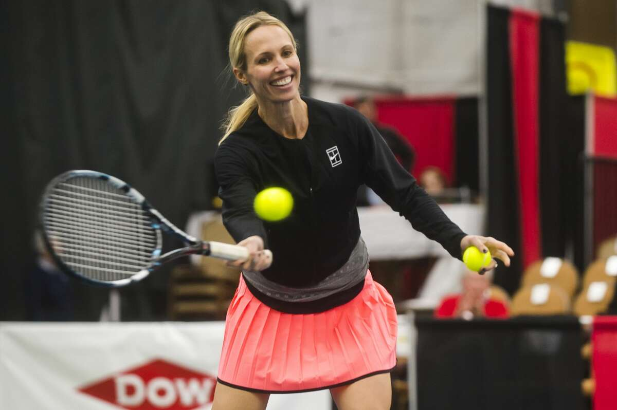 Anne (Miller) Borus warms up before a doubles match with Liezel Huber, Kari Miller and Ellie Coleman on Monday, Jan. 29, 2018 during the Dow Tennis Classic at the Greater Midland Tennis Center. (Katy Kildee/kkildee@mdn.net)