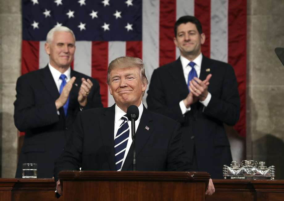 President Trump, seen here during a speech before Congress in February 2017, will be flanked again by Vice President Mike Pence and House Speaker Paul Ryan of Wis., on Tuesday, Jan. 30, 2018, during his State of the Union address. (Jim Lo Scalzo/Pool Image via AP, File) Photo: Jim Lo Scalzo, Associated Press